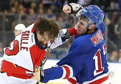 The Rangers pound the Panthers, and New York's John Moore (right) seems to get the better of Florida's Jack Skille here.  (USATSI)