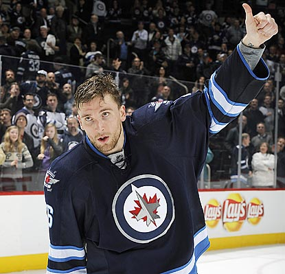 First-star honoree Blake Wheeler salutes Jets fans after Winnipeg extends its winning streak to five.  (Getty Images)