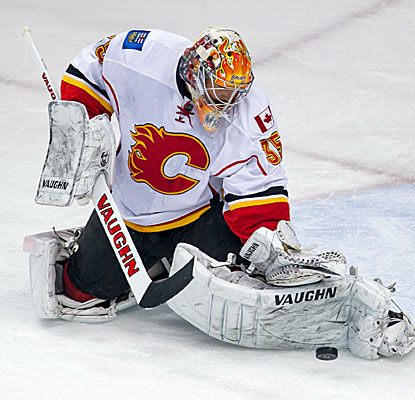 Calgary's Joey MacDonald makes 34 saves to help the Flames to victory over Minnesota. (USATSI)