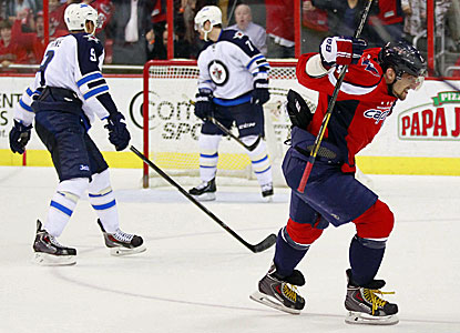 Alex Ovechkin celebrates after scoring an empty net goal against the Winnipeg Jets. (USATSI)