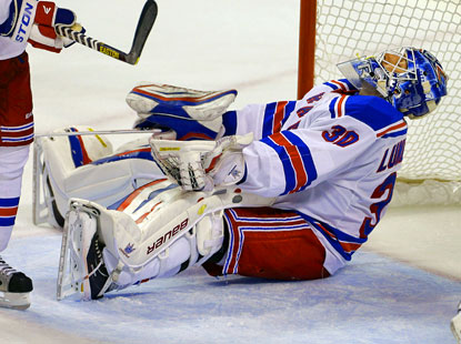 Rangers goalie Henrik Lundqvist reacts after allowing a goal to the Panthers' Filip Kuba. (AP)
