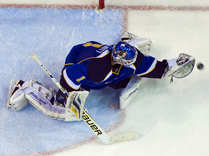 Blues goalie Brian Elliott makes a save during the second period, one of his 17 saves against the Avalanche. (USATSI)