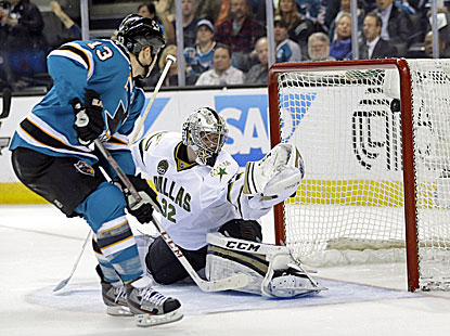 Sharks left winger Raffi Torres (left) scores past Stars goalie Kari Lehtonen in the first period. (AP)