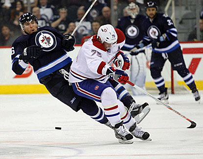 Montreal's Max Pacioretty collides with the Jets'  Blake Wheeler as they battle for the puck. (USATSI)