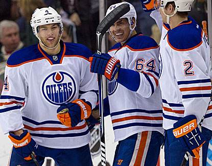 Taylor Hall (left) scores a goal and adds two assists in the Oilers' laugher of a win over the Wild. (USATSI)