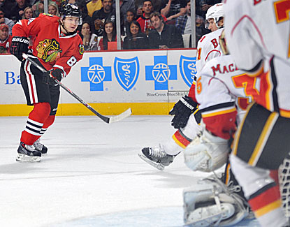 Chicago's Patrick Kane shoots and scores a goal against Calgary goalie Joey MacDonald just 9:34 into the game. (USATSI)