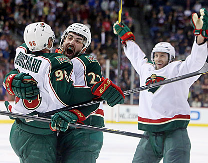 Pierre-Marc Bourchard adds an empty-netter late in the third as the Wild clinch the No. 8 seed in the West. (USATSI)