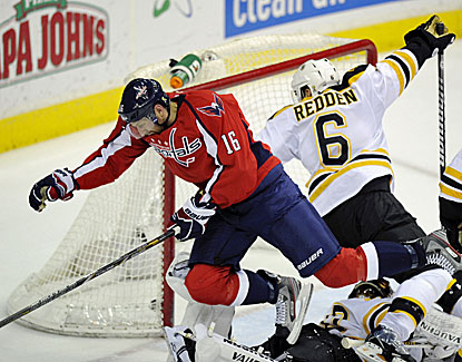 Eric Fehr scores in overtime to push Washington past Boston and prevent the Bruins from clinching the Northeast Division. (AP)