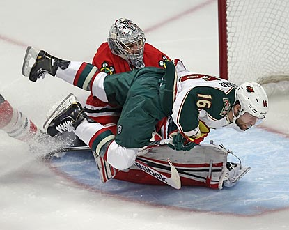 Chicago goalie Corey Crawford stops 26 of 27 shots and hangs tough against Torrey Mitchell and a game Minnesota squad.  (Getty Images)