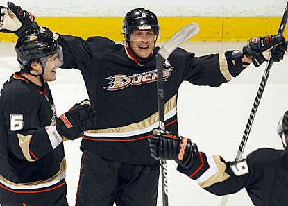 Teemu Selanne (center) celebrates after his 42nd career postseason goal puts Anaheim ahead to stay. (Getty Images)