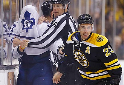 For most of the game, Chris Kelly and the Bruins make Leo Komarov and the Maple Leafs look a little silly.  (Getty Images)