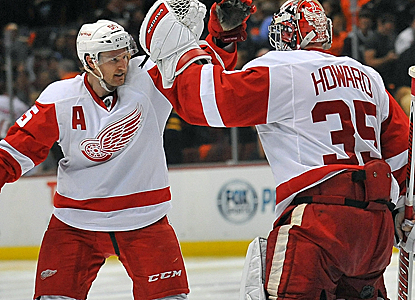 Gustav Nyquist celebrates with Wings goalie Jimmy Howard after netting the game-winner in OT.  (USATSI)