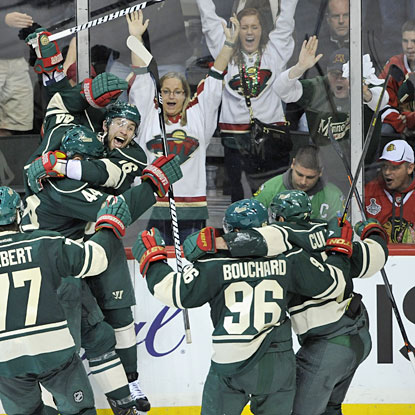 Wild fans are thrilled after Jason Zucker's game-winning goal; Blackhawks fans have no reason to celebrate.  (Getty Images)