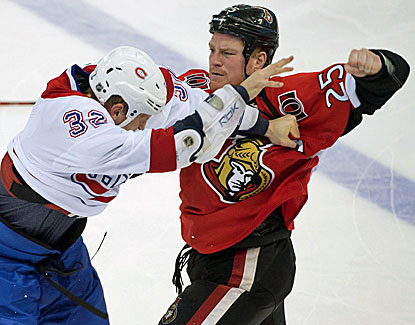 Montreal's Travis Moen and Ottawa's Chris Neil go at it as the teams combine for 236 penalty minutes in the Sens' 6-1 win. (USATSI)