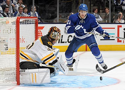 Boston's Tuukka Rask makes 45 saves, including this denial of Toronto's James van Riemsdyk.  (Getty Images)
