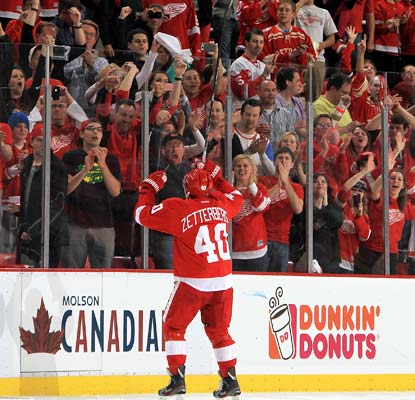 Henrik Zetterberg breaks out of his slump in a big way, scoring two goals, the last coming in overtime.  (Getty Images)
