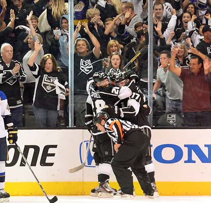 The Kings celebrate Dustin Penner's buzzer-beating goal at the end of the second period. It proves to be the deciding score.   (Getty Images)