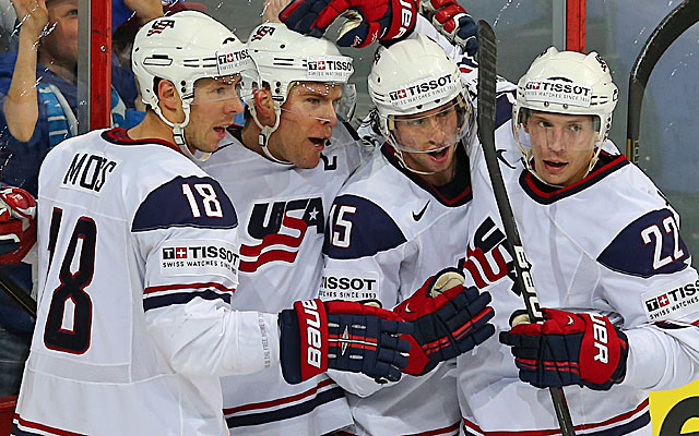 Paul Stastny (second from left) celebrates with teammates after scoring Team USA's first goal.(Getty Images)