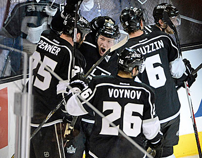 Trevor Lewis sends Staples Center over the edge with the Kings' second goal in a 22-second span to defeat San Jose. (USATSI)