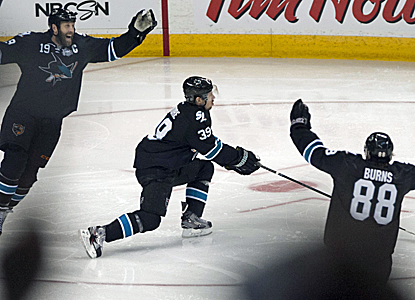The Sharks celebrate Logan Couture's game-winning goal in overtime that trims the Kings' series lead in half.  (USATSI)
