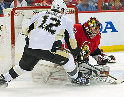 Penguins right wing Jarome Iginla shoots on Senators goalie Craig Anderson. Iginla scores twice against Ottawa. (USATSI)