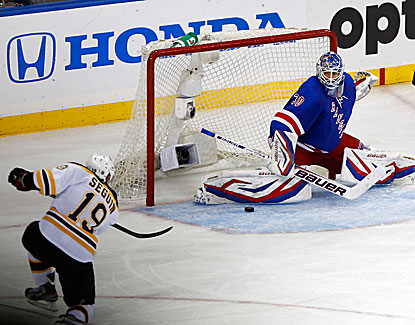 Rangers goalie Henrik Lundqvist makes the save on Boston's Tyler Seguin in New York's overtime win in Game 4. (USATSI)