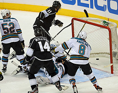 LA's Anze Kopitar gets the puck past Sharks goalie Antti Niemi in the Kings' 3-0 win in Game 5. (USATSI)