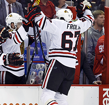 Michael Frolik celebrates one of Chicago's three third-period goals as the series heads for Game 7.  (USATSI)