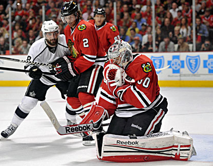 Blackhawks goalie Corey Crawford makes one of his 21 saves against the Kings in Game 1. (USATSI)