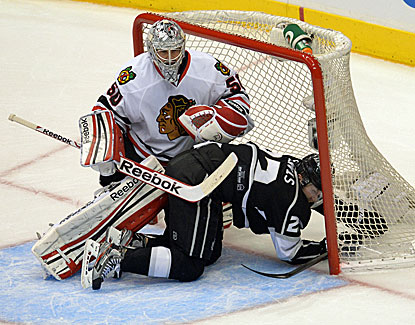 Corey Crawford makes 19 saves for the Blackhawks, who are one win away from a berth in the Stanley Cup Final. (USATSI)