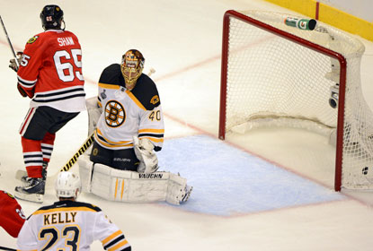 Andrew Shaw scores on a deflection in triple overtime, beating Bruins goalie Tuuka Rask in Game 1. (USATSI)