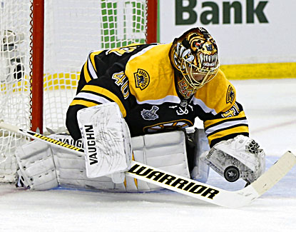 Tuukka Rask makes one of his 28 saves during the Bruins' 2-0 win. It was his third shutout of the 2013 playoffs. (USATSI)