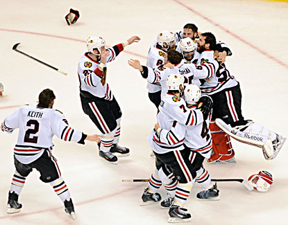 Blackhawks players celebrate with goalie Corey Crawford (far right) after beating the Bruins 3-2 for the Stanley Cup. (USATSI)