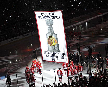 The Blackhawks raise another Stanley Cup banner before opening their title defense with a come-from-behind victory.  (USATSI)