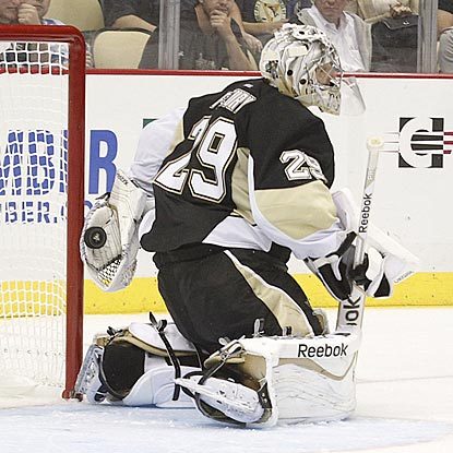In the third period, Marc-Andre Fleury makes a behind-the-back save after the puck goes off the post and then his shoulder.  (USATSI)