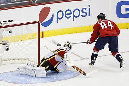 Washington's Mikhail Grabovski, who scored a hat trick on opening night, beats Karri Ramo during the shootout.  (USATSI)