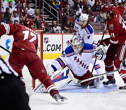 Radim Vrbata slams a rebound past Henrik Lundqvist in the third period to complete his natural hat trick.  (USATSI)