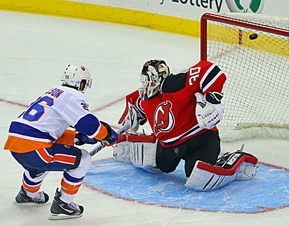 Matt Moulson puts the game-winner past Martin Brodeur in the Islanders' season-opening victory over New Jersey. (USATSI)