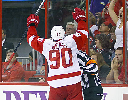 Stephen Weiss sends the Red Wings to a 3-2 victory with an overtime goal against the Hurricanes. (USATSI)