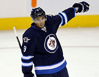 Evander Kane scores a goal with two assists as Winnipeg opens its home slate with a 5-3 win over the Kings. (USATSI)