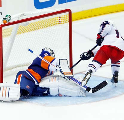 Cam Atkinson scores in the fourth round of the shootout to cap the Blue Jackets' rally against the Islanders.  (USATSI)