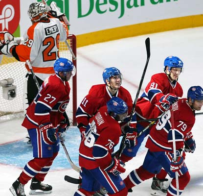 The Canadiens celebrate Brendan Gallagher's (11) goal in a 4-1 victory over the Flyers in Montreal.  (USATSI)