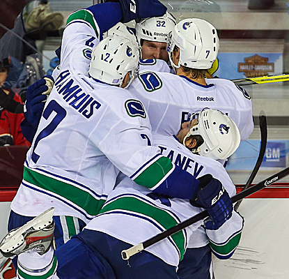 Dale Weise celebrates his goal with teammates as the Canucks erase a two-goal third-period deficit.  (USATSI)