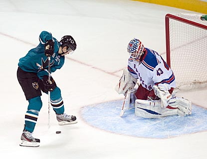 For his fourth goal, Tomas Hertl puts the puck between his legs before shooting it over Martin Biron's shoulder.  (USATSI)