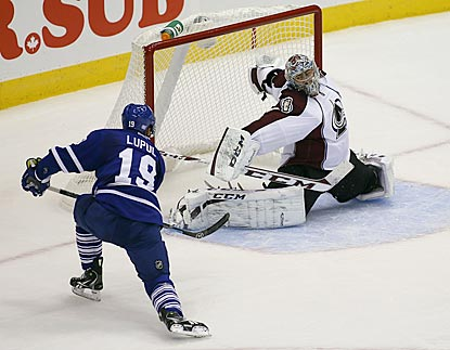 Colorado goaltender Semyon Varlamov makes sure Toronto's Joffrey Lupul doesn't convert a scoring chance in the first period.  (USATSI)