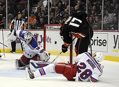 Henrik Lundqvist (left) and John Moore can't prevent Dustin Penner from scoring in the second period.  (USATSI)