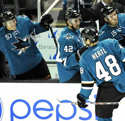 Tomas Hertl, only a rookie, scores his league-leading seventh goal before leaving with an injury.  (USATSI)