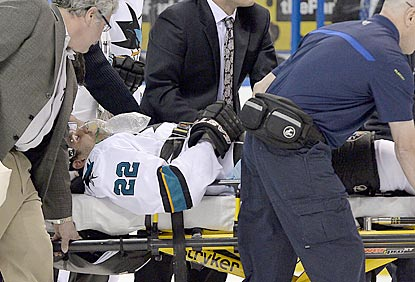 Dan Boyle is taken off on a stretcher after going face-first into the glass from an illegal check from behind.  (USATSI)