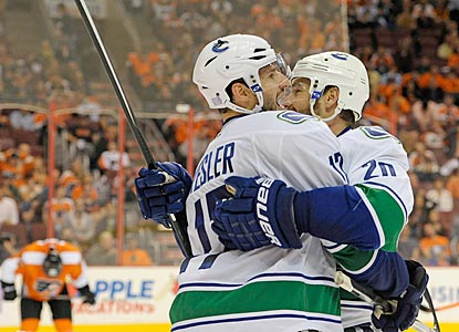 Ryan Kesler (left) celebrates his tiebreaking goal with Chris Higgins, whose goal tied the game earlier in the third period.  (USATSI)
