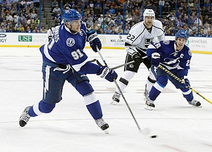 Steven Stamkos fires a shot, which teammate Martin St. Louis (right) converts for a goal on the rebound in the second period.  (USATSI)